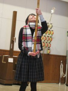 student practices balancing a kanto festival pole