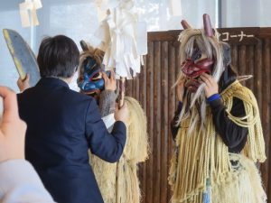 Akita International University students in namahage costumes
