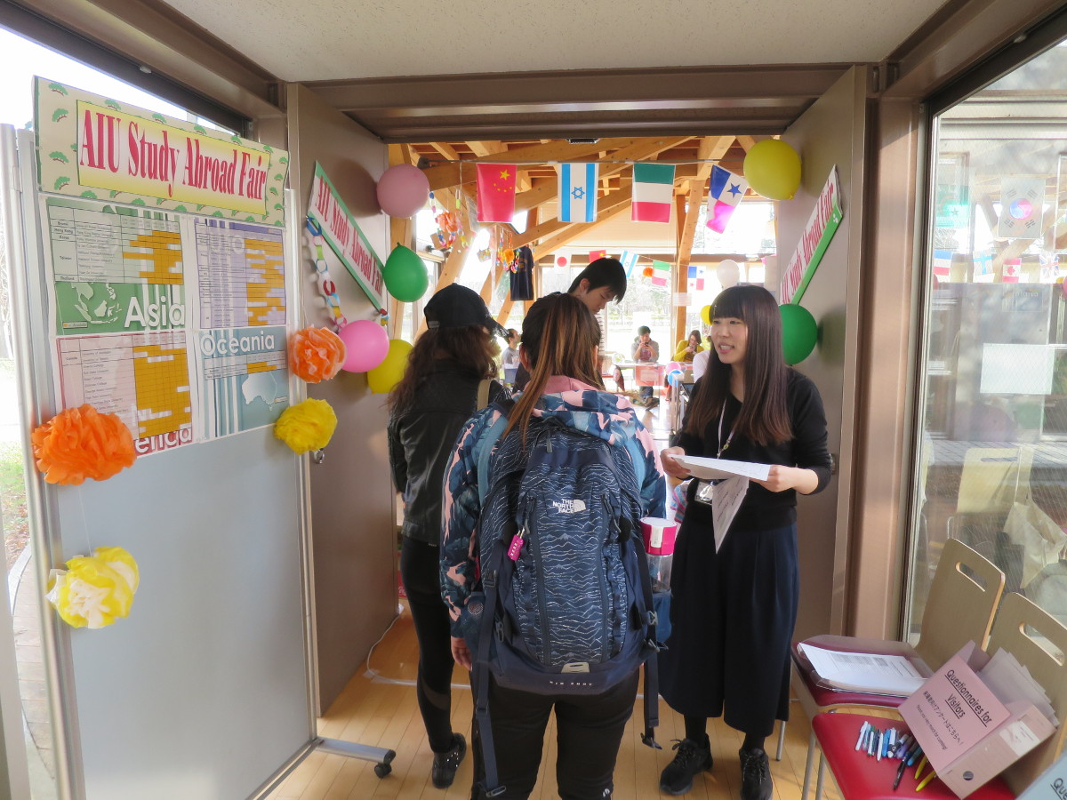 Akita International University Center for International Affairs staff greets student participants at the fair